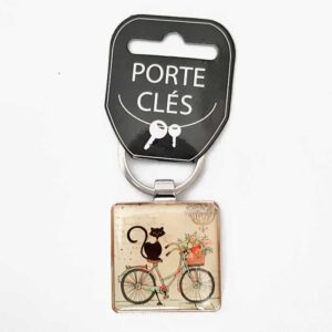Porte-clés chat sur un vélo collection Bug Art